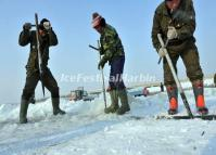 Workers Dig Ice from the Songhua River