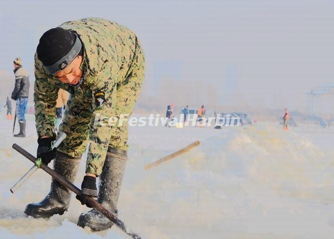 A Worker Dig Ice for the 15th Harbin Ice and Snow World