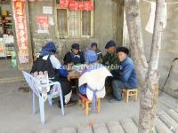 The Old Naxi People Play Mahjong in the Street of Baisha Old Town