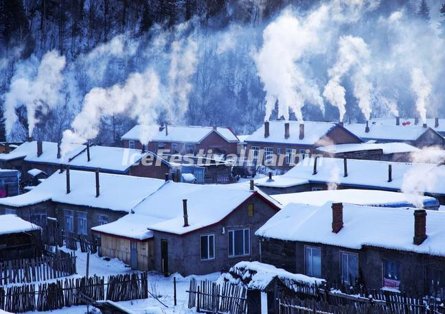 Smoke from Cooking Stoves Floating Above the Roofs of Village Houses in China's Snow Town