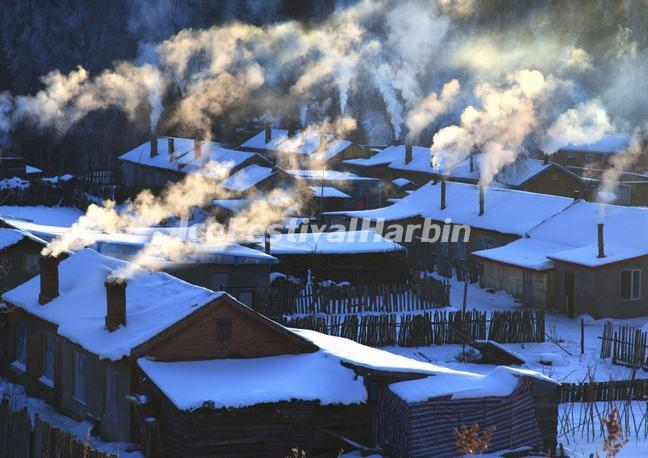Chimney Smoke Rose from the Cottages in China's Snow Town