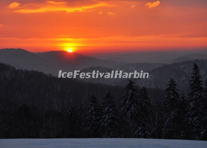 Sunrise Over Yangcao Mountain in China's Snow Town