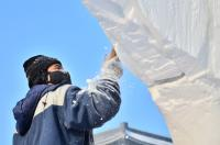 A Sculptor Is Making A Snow Sculpture in Harbin