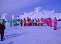 A Group of Old Women Perform the Yangko in Front of a Giant Snow Sculpture on Sun Island