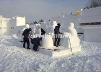 Tourists Make Snow Sculptures in Harbin Stalin Park