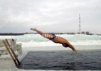 A Winter Swimmer Take a Dive at Harbin Ice Festival