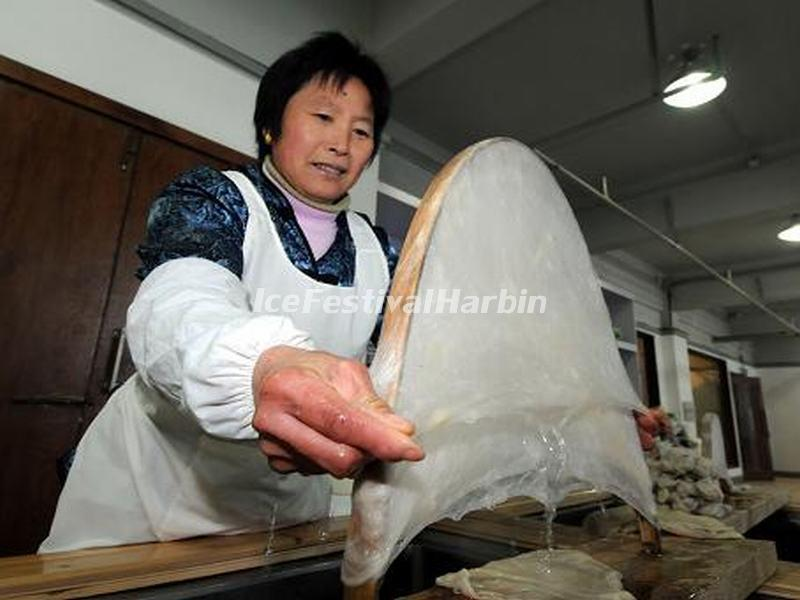 A Worker is Making Silk in Shanghai Jiangnan Silk Museum