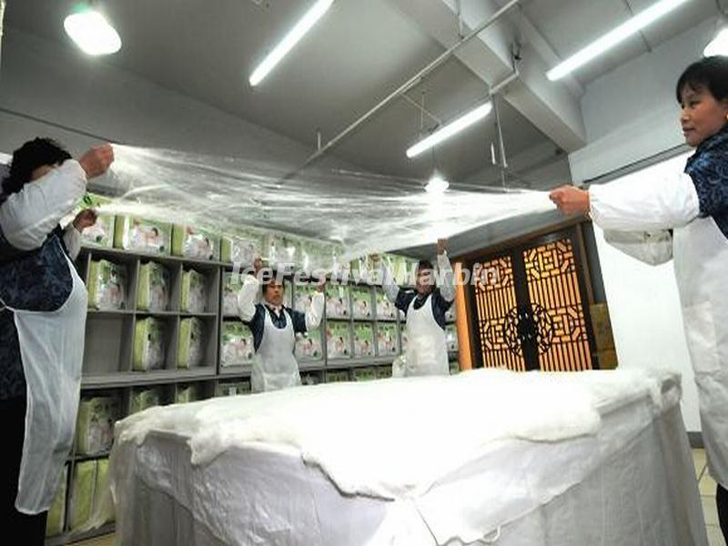 The Workers Are Making Silk Bedsheet in Jiangnan Silk Museum