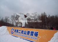 A Tourist Enjoys Snowboarding in Harbin Longzhu Erlongshan Ski Resort