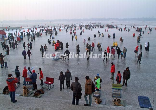 Tourists in Harbin Songhua River Ice and Snow Happy Valley