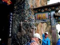Tourists at the Dragon Gate in Western Hills Forest Reserve
