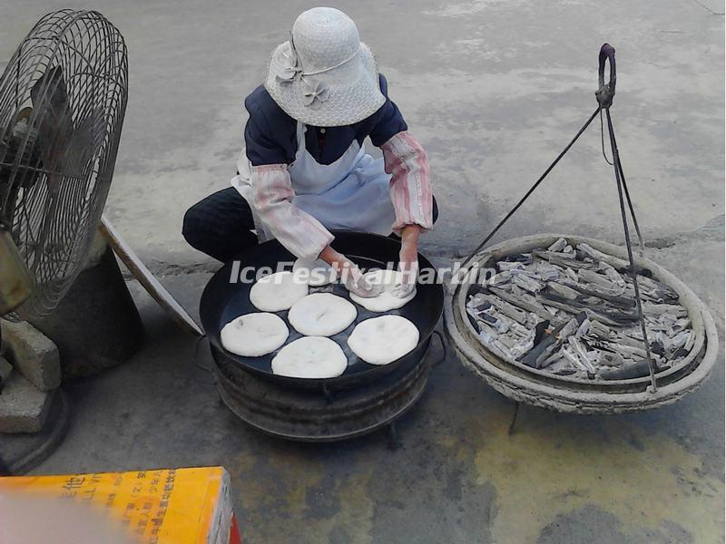 A Woman is Making Xizhou Baba (cake) in Xizhou Town